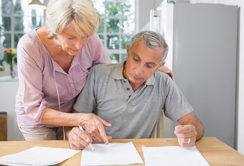 Senior Couple Writing A Will